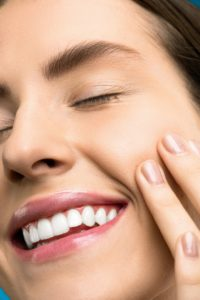 Woman with an attractive smile after cosmetic dentistry